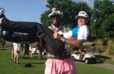 Here's a picture of Shaq holding Bubba Watson like a baby