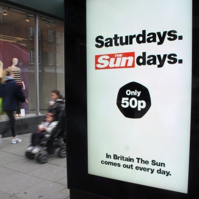 Sun reporter, prison officer charged in British bribery probe