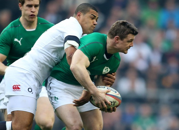 Brian O'Driscoll is tackled by Luther Burrell