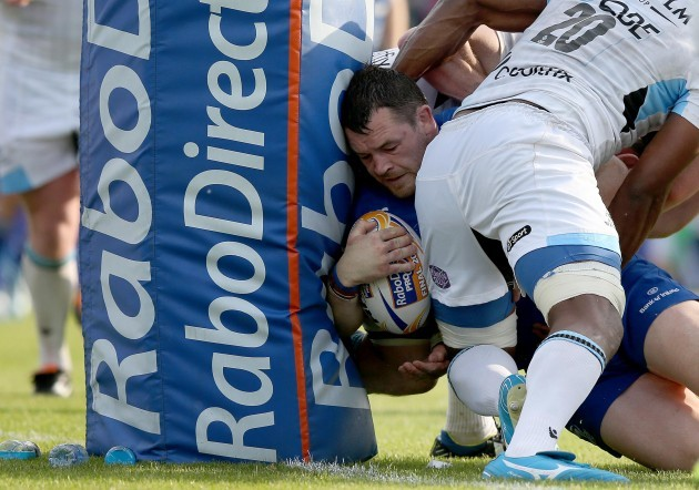 Cian Healy nearly scores a try but is held in the tackle