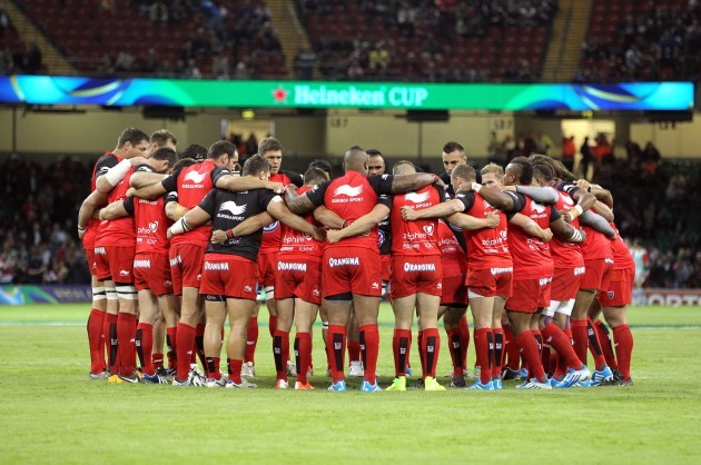 The Toulon team huddle before the game