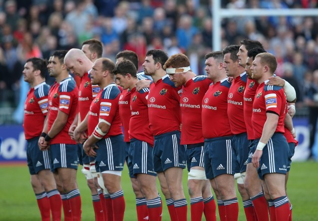 Munster team line up for a minutes silence