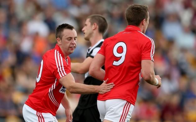 Paul Kerrigan celebrates with Aidan Walsh