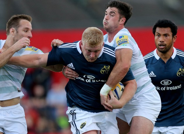 Tomas O'Leary and Eamonn Sheridan tackle John Ryan