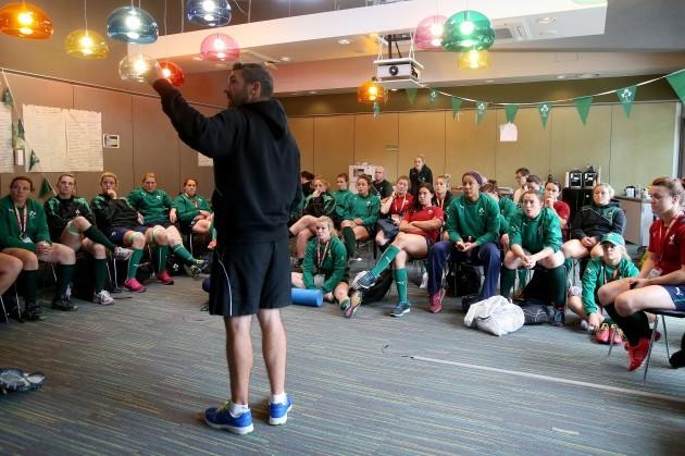 The Irish players listen to Greg McWilliams