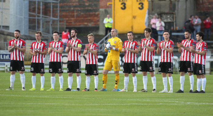 Derry players during the minute's applause in memory of Bishop Edward Daly
