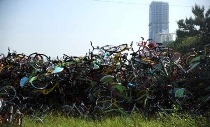 Thousands of share bikes detained in a sports field