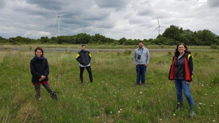Catherine Farrell (l) on field research with other members of INCASE team