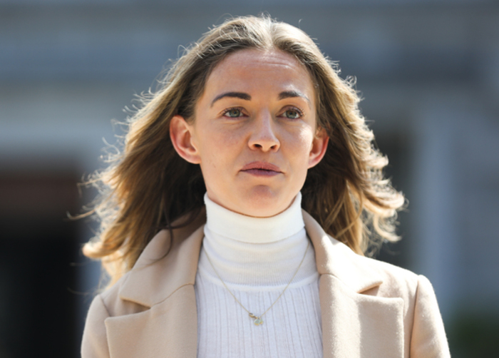 Closeup of TD Holly Cairns wearing a white polo neck and cream jacket.